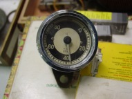 Original tach, a nice accessory, obviously needs some work.