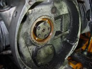 Flywheel off, bad news is that those screws holding the oil pump cover on are going to be a bear